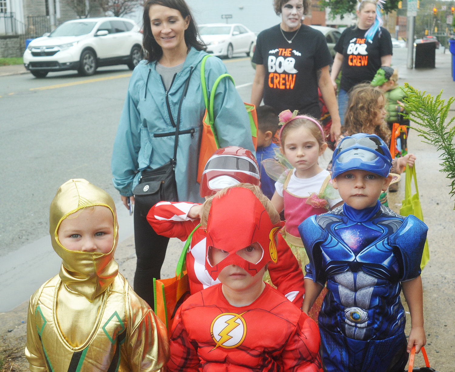 The Flash and other characters made an appearance in downtown Siler City last Thursday for Halloween. The students and staff members from the Children's First day care and Learning Center took a brief tour on the overcast day to collect candy from shop-keepers.