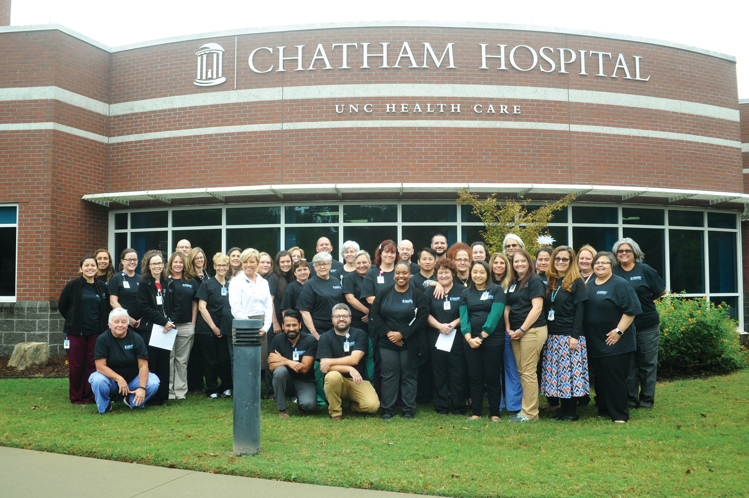 Standing with the team.Caregivers at the Chatham Hospital gathered last Tuesday to reaffirm the statements in the Carolina Care plan. The plan offers specific expectations that are part of the UNC health care systems that are needed for excellent patient care.