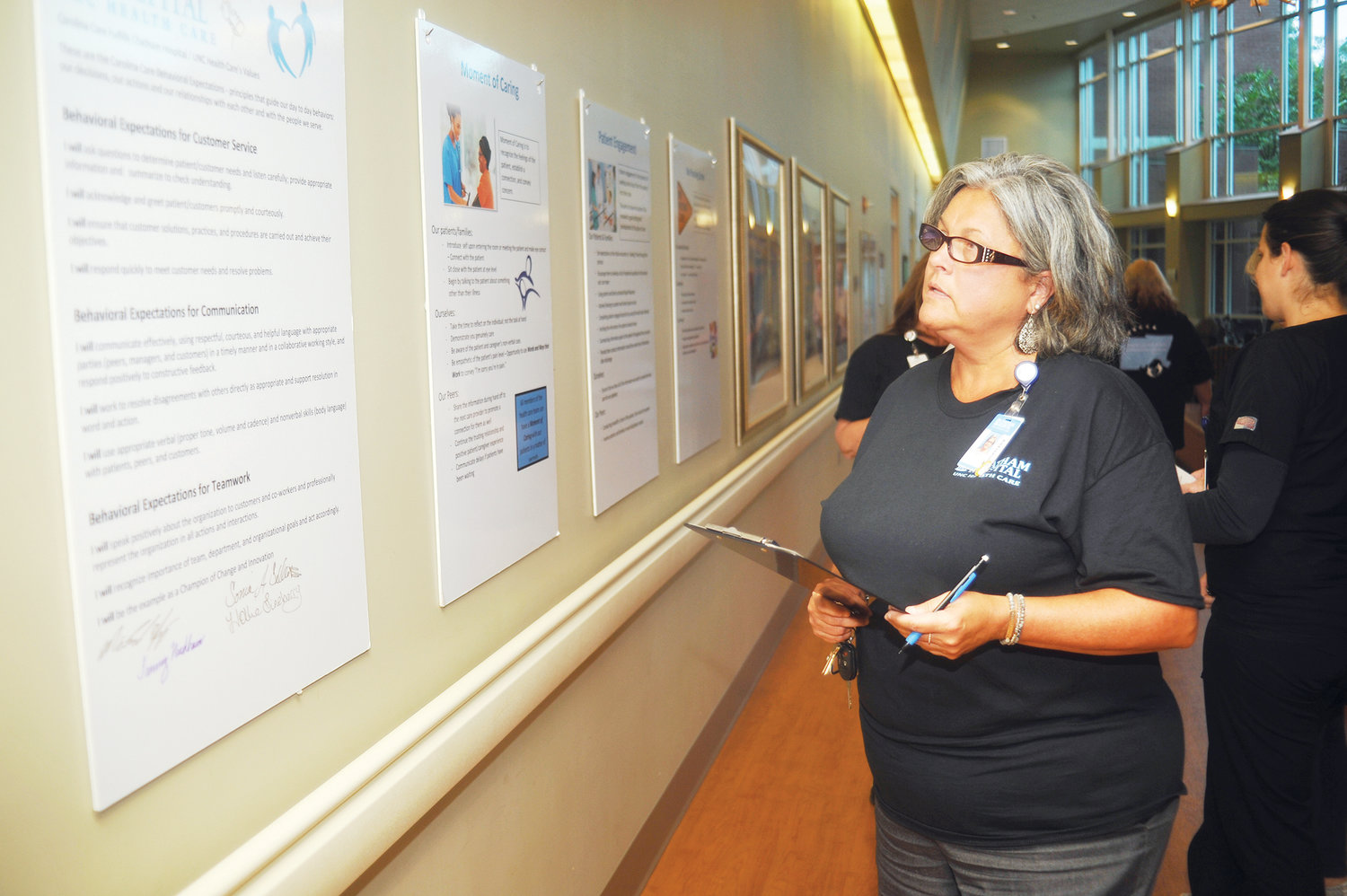 Improving service and care for our customers.Kathy Brown reviews precepts spelled out by the signs about the goals and expectations of the UNC caregiving system Oct. 22. 'It's a reminder,' she said. 'About how we improve service excellence in the system, and a refresher course in customer care.'