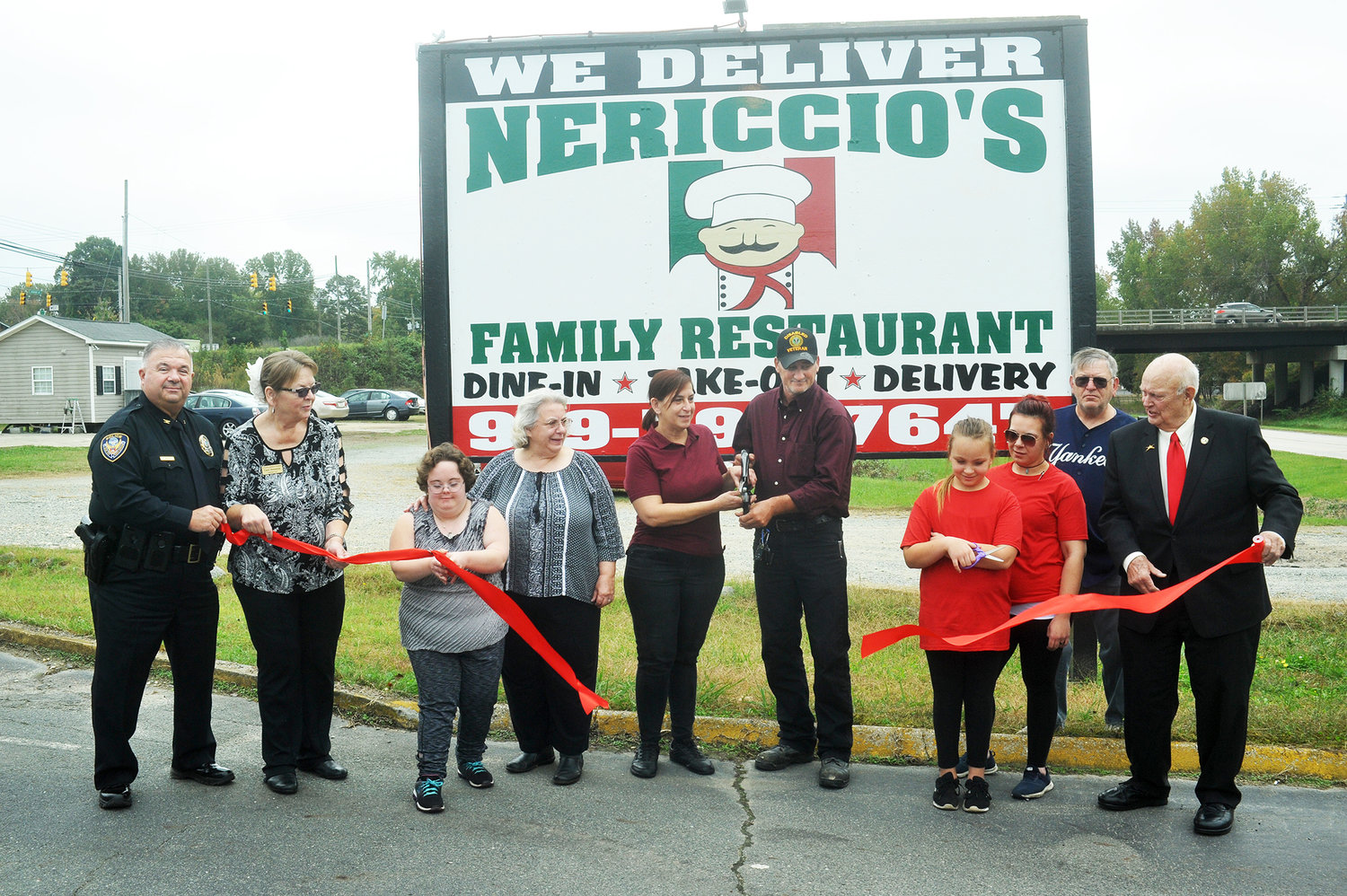 Friends and family joined Siler City Police Chief Michael Wagner and Mayor John Grimes to cut the ribbon on Nerricio's, a new business in town, with co-owners Mary and Stephen Boyce at 1110 N. 2nd Ave. in Siler City last Tuesday. 'The opening shows confidence in investing money in Siler City,' Grimes said. 'The enterprise has a good chance of succeeding because of Mountaire and the growing economy. Because of new management and money moving around, more independent small businesses now have a very good chance of being successful.' The restaurant is located in the former home of 'The Copper Penny,' and offers a variety of Italian foods for patrons.