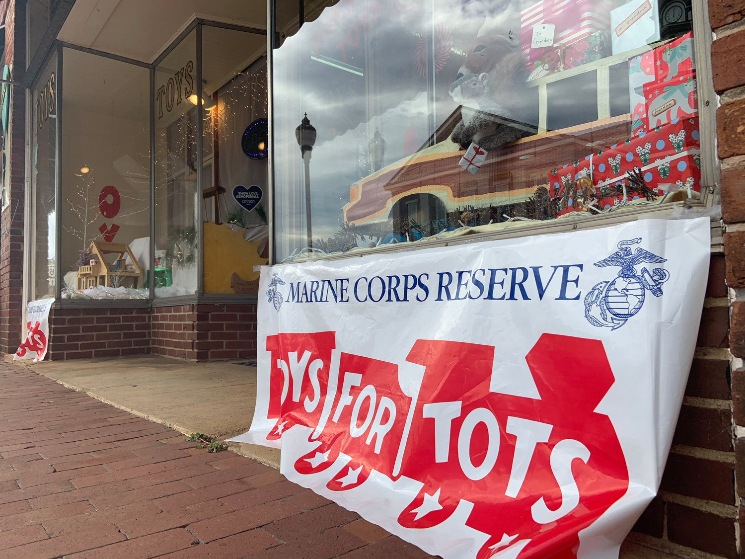 Pittsboro Toys marks its designation as a Toys for Tots drop-off site with this banner outside its store. Several places around the county are drop-off sites for Toys for Tots, a prgram run by the U.S. Marine Corps Reserve which distributes toys to children whose parents cannot afford to buy them gifts for Christmas.