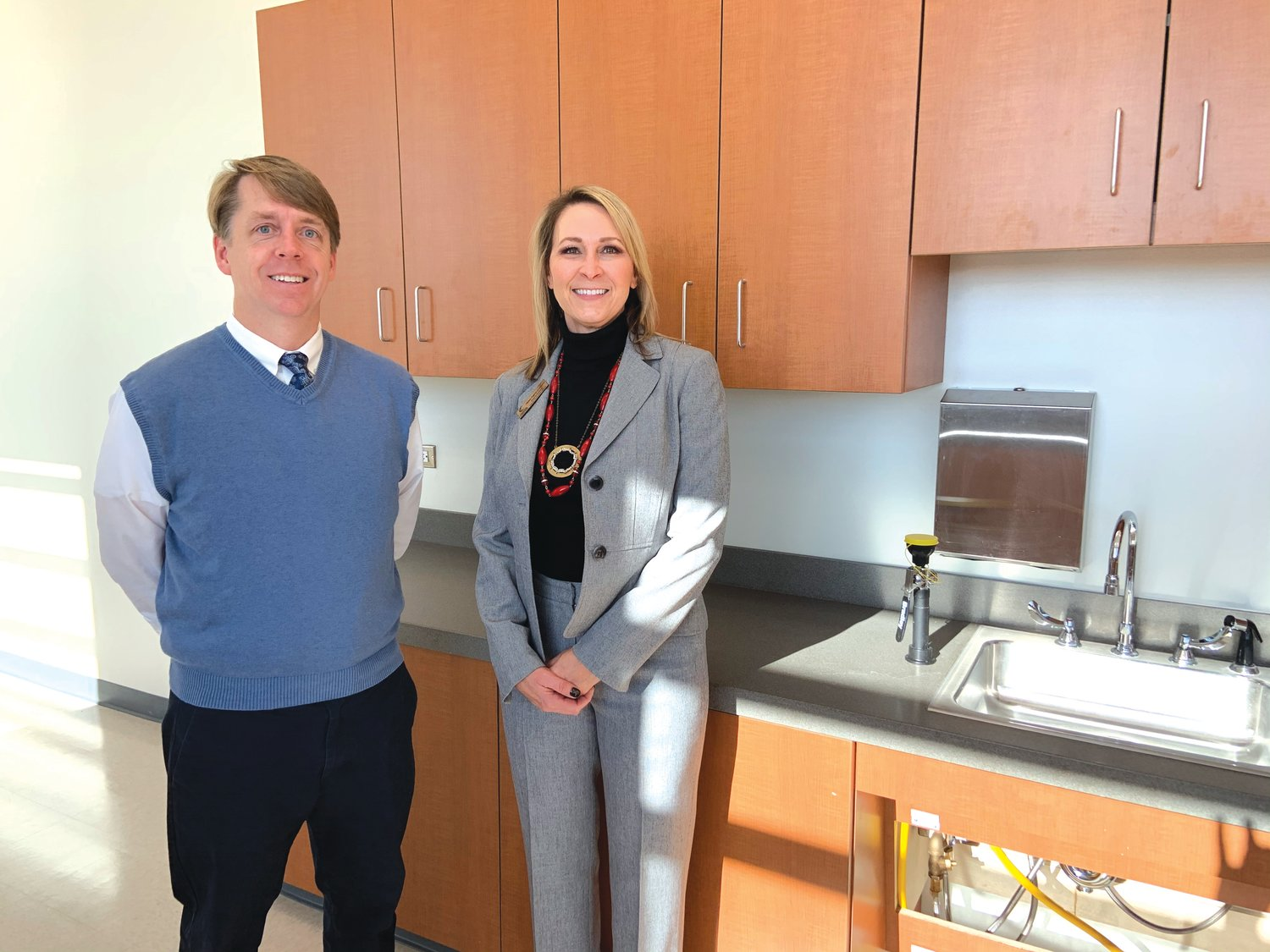 CCCC's Chatham Provost Mark Hall, left, and Health Sciences Building Site Coordinator Melissa Fogarty stand in the laboratory where medical assisting students will practice lab work.