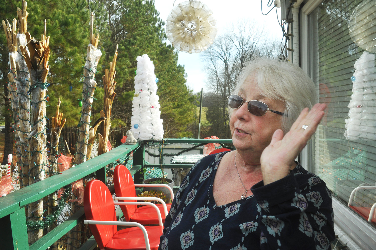 Glenda Johnson, surrounded by strings of holiday lights decorating the family home on U.S. Hwy. 64 between Siler City and Pittsboro, said she has received many 'thank-yous' over the years for her house's displays.