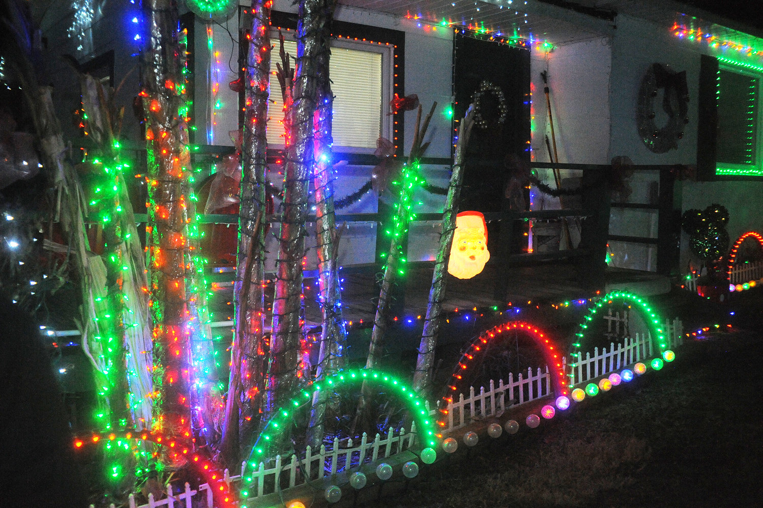 LED lights in circular arrays are bounded by strings of lights and vintage blow-mold lamps in a festive array around the Mace house on U.S. Hwy. 64. This year, the family estimates that 50,000 lights were used.