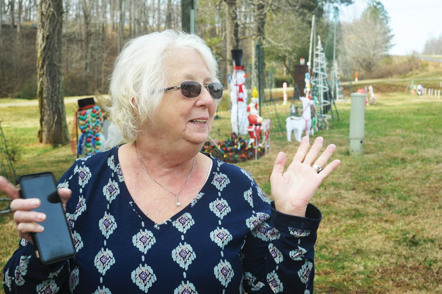 The yard lights are off during the day, but at night, Glenda Johnson says that she hears the sounds of Jake brakes and 18-wheeler horns to say thanks for the well-lit structure, sometimes at 3 a.m.