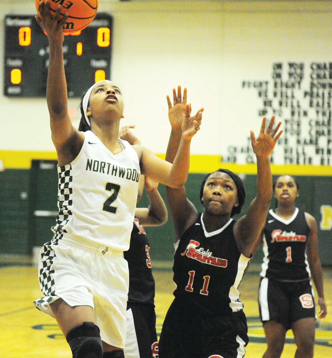 Northwood's Rae McClarty gets past the Southern Durham defense of Amyah Ingram (11) and Taylor Robinson in the first game of 2020 for both teams in Pittsboro last Friday. Northwood won the game 43-35.