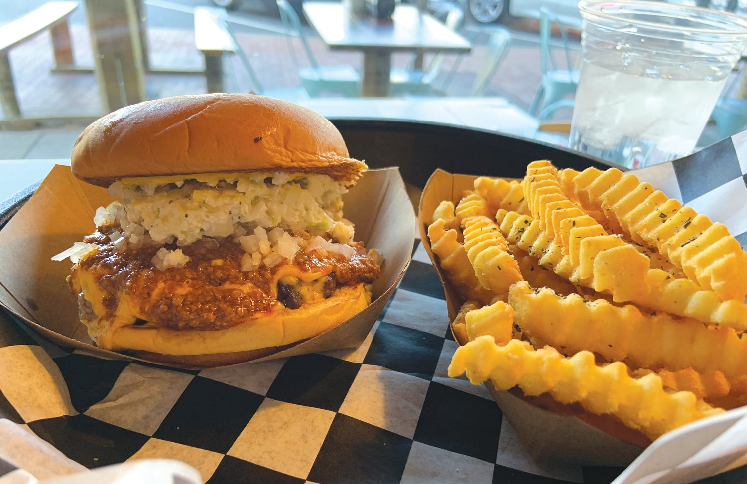 Pictured is the Bobo Chili Cheese burger — one patty stacked with chili, slaw, chopped onions, cheese and mustard — at Al's Burger Shack, a local chain based out of Chapel Hill. The restaurant filed for bankruptcy for its three locations two weeks ago, but plans to continue to expand during its reorganization process.