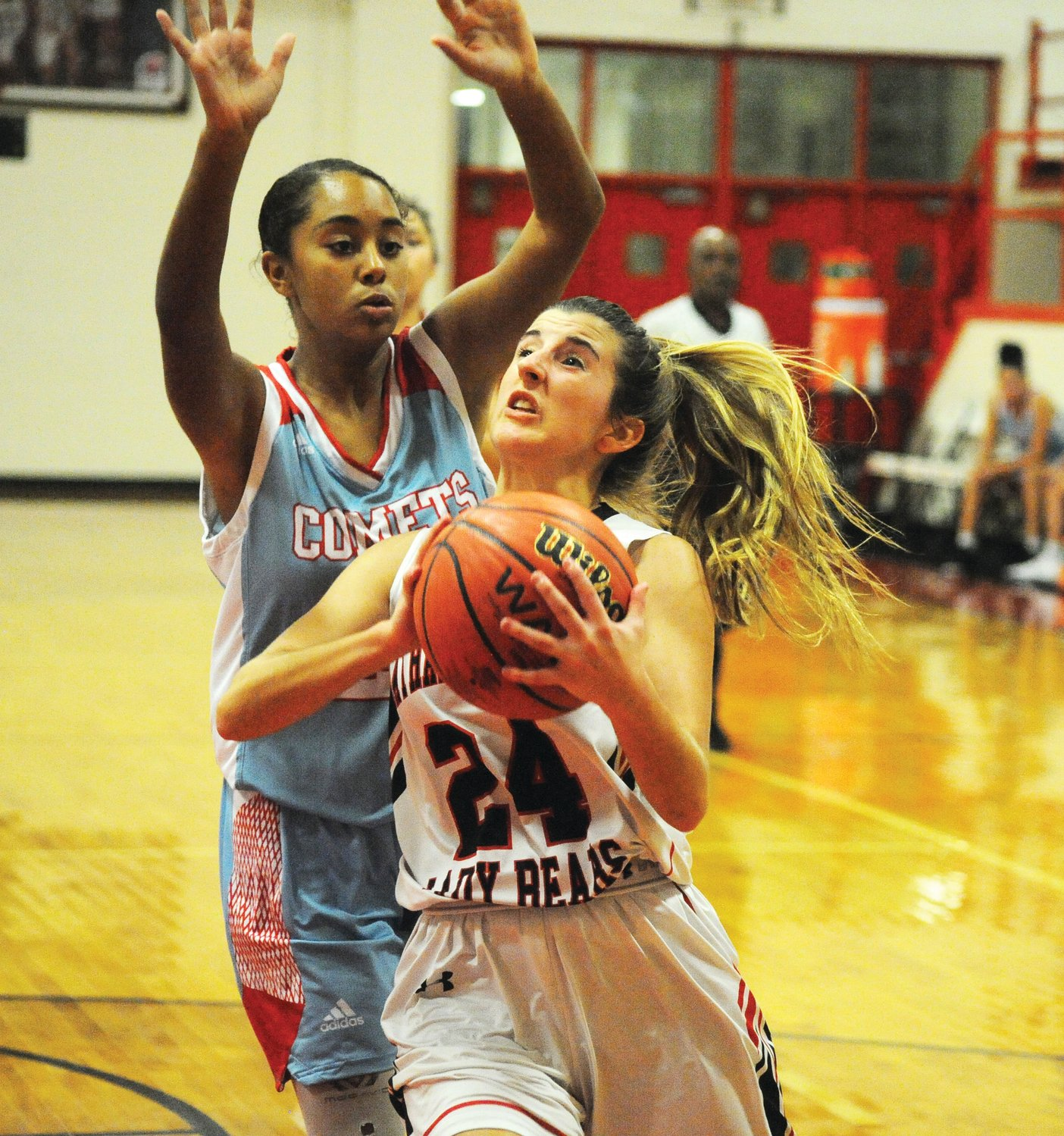 North Stanly's Nyleiah White is passed by Chatham Central's Mary-Grace Murchison in conference match last Friday in Bear Creek. The contest was no match for the Bears as they trounced the Comets, 56-26.