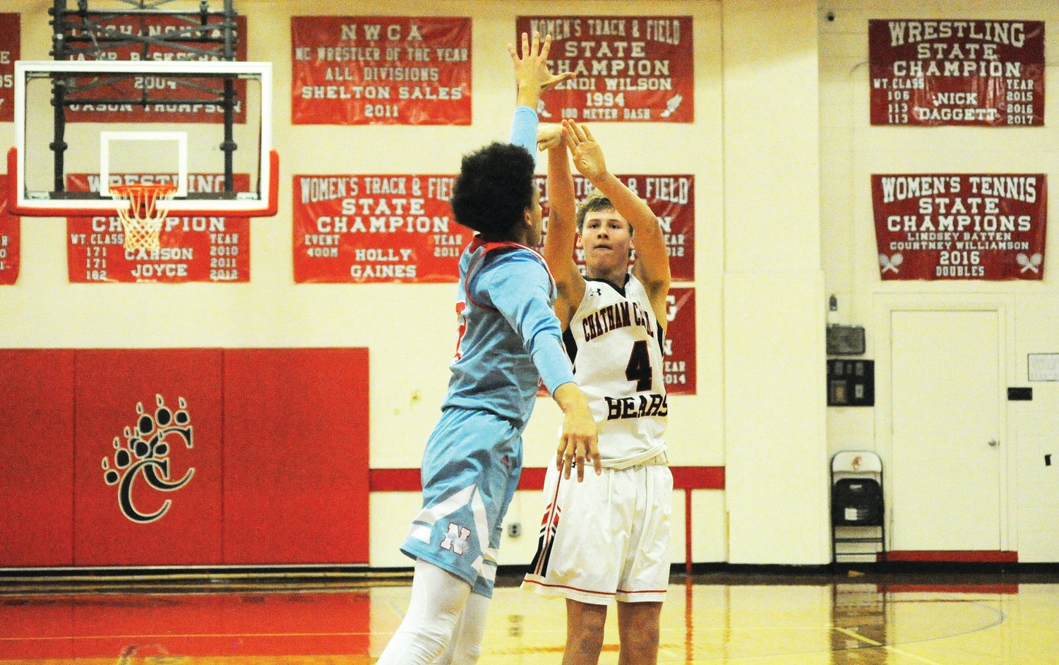 Chatham Central's Michael Moore scores his 1,000th point in the final seconds in the second quarter of last Friday's game with North Stanly in Bear Creek.