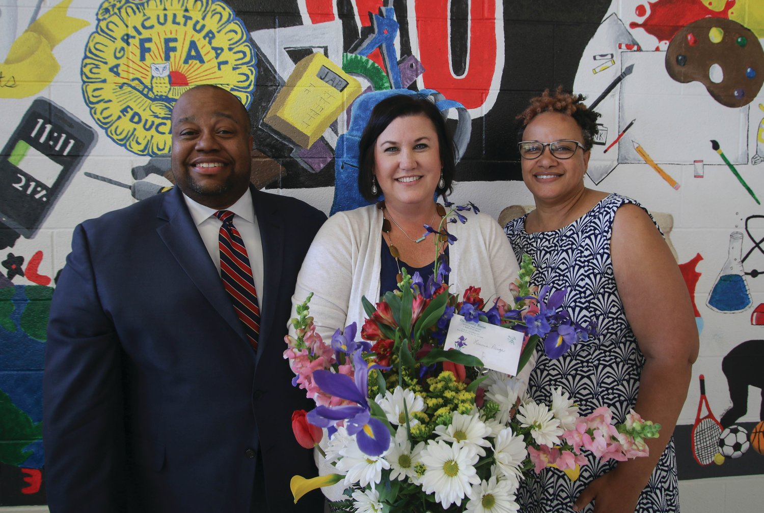 Chatham Central High School educator Laurie Paige (center), the reigning Chatham County Schools Teacher of the Year, is pictured with Chatham County Schools Superintendent Dr. Derrick D. Jordan and Chatham Central Principal Dr. Karla Eanes.