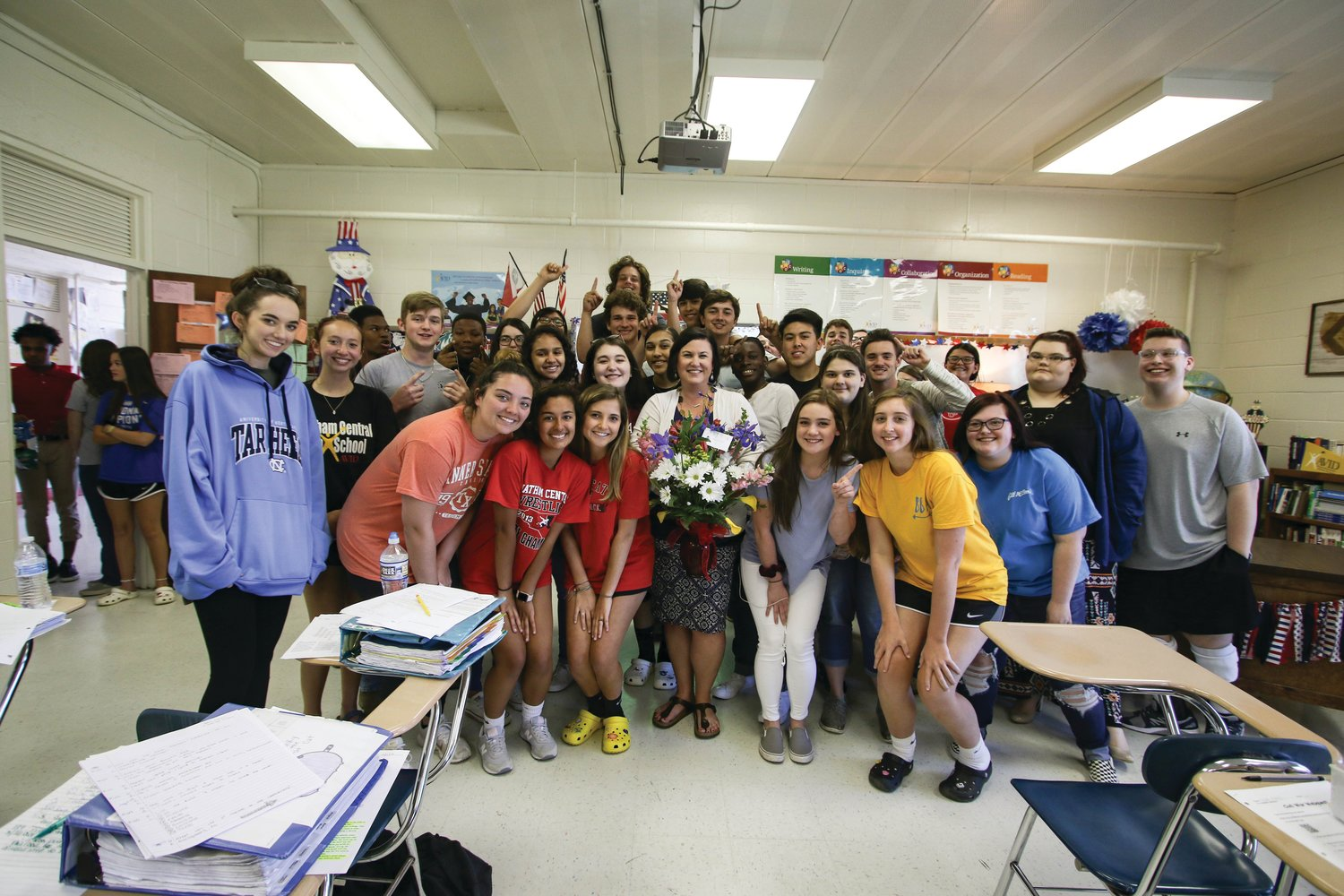 Chatham Central High School educator Laurie Paige (center), the reigning Chatham County Schools Teacher of the Year, is surrounded by some of her students during the 2018-19 school year.