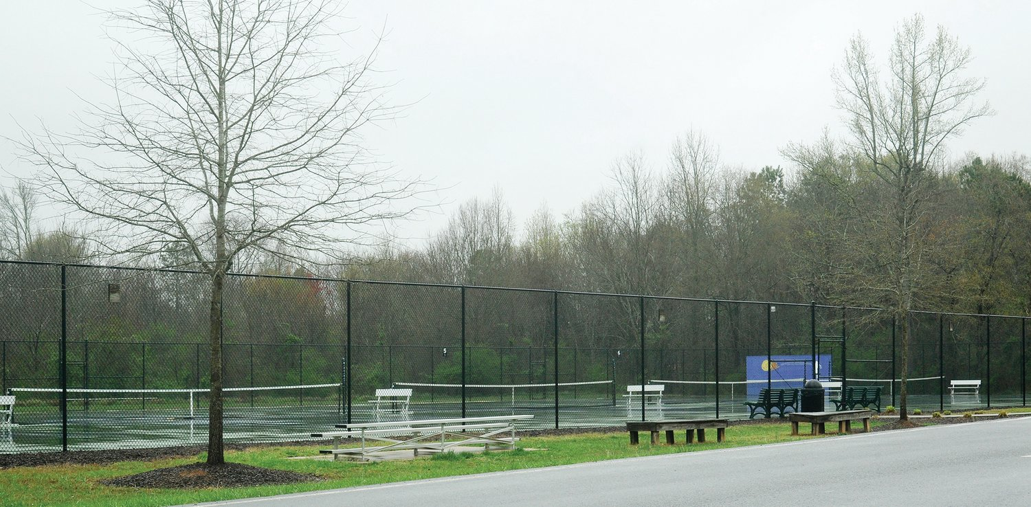 It's a dreary day in two ways at the tennis courts at Chatham Charter School. Rain on Monday washed out the already empty courts because of the virus crisis. Gov. Roy Cooper has locked down schools throughout the state until May 15, and perhaps longer.