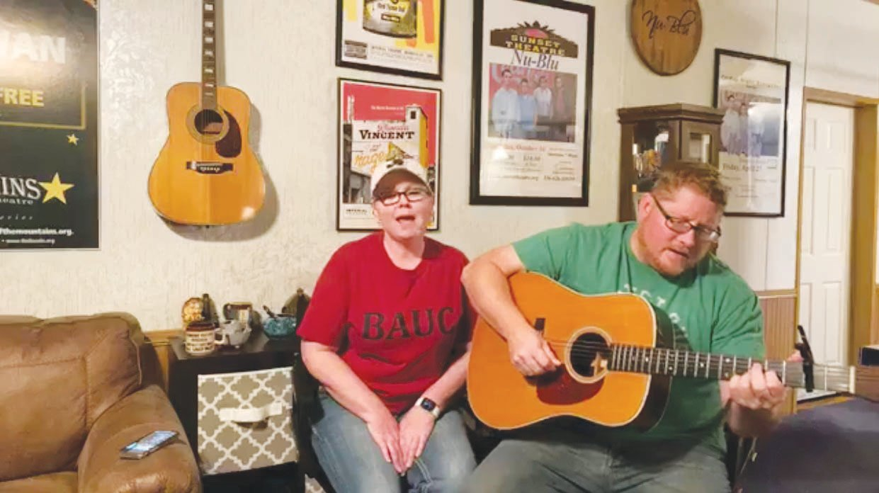 Husband and wife musicians Carolyn and Daniel Routh, of the bluebrass band Nu-Blu, are still reaching fans despite having to delay numerous scheduled gigs. Here they perform 'Angel From Montgomery' for fans during a Facebook livestream. The song's composer, John Prine, was critically ill with COVID-19 earlier this week.