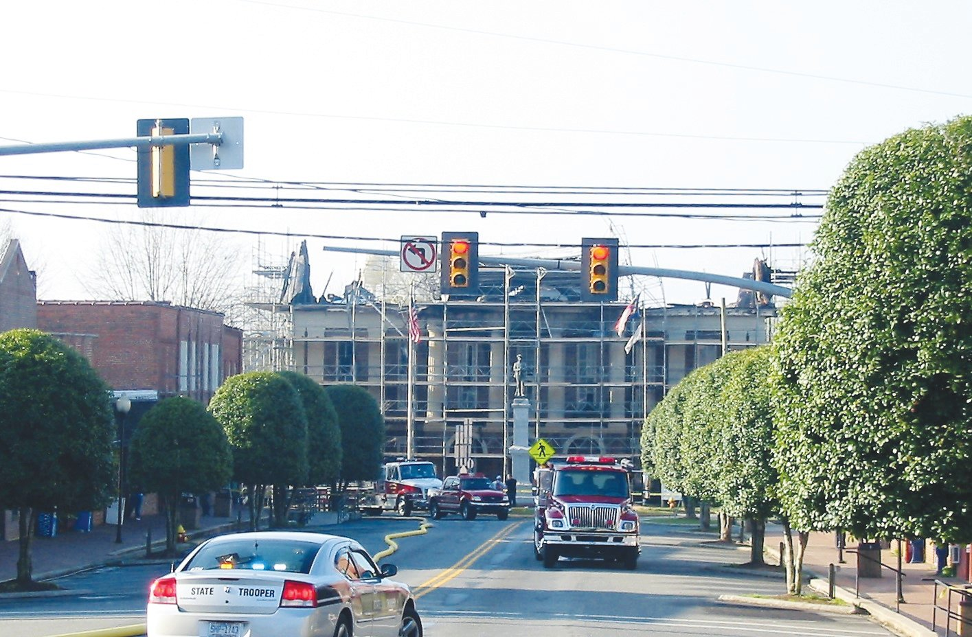 The view from Hillsboro Street shows the badly-damaged courthouse, still surrounded by scaffolding from renovations under way when the fire errupted.