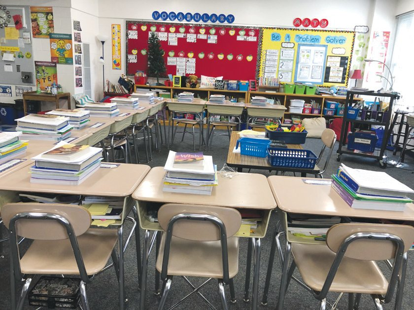 "Susan Loflin, Fourth Grade Teacher at Bennett School, took a picture of her empty classroom before she sent home the first round of at-home learning packets. She said she took the photo to ""record this moment in history."""