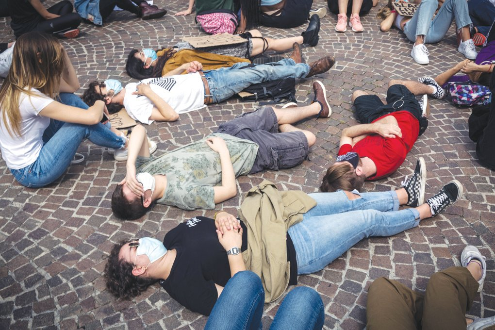 Protestors lay on the ground for the same length of time as George Floyd at the United We Stand rally on June 6 in Vicenza, Italy.