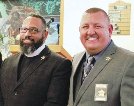 Rev. Corey Little (left), Pastor of Mitchell's Chapel AME Zion Church in Pittsboro participated in the forum on police reform with law enforcement including Chatham County Sheriff Mike Roberson (right). This photo was taken prior to COVID-19 at Rev. Little's Church.