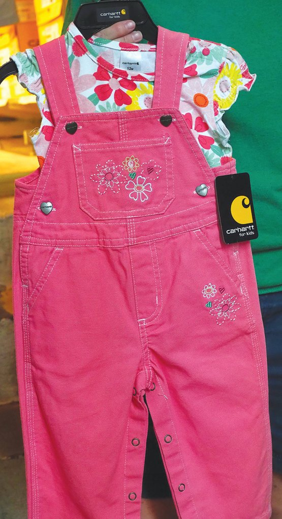 King-McDaniel said the store's large selection of Carhartt jackets and work boots are their best sellers. The store mostly offers men's apparel and boots, but they also have a some women's and kids' clothing — like these Carhartt kid overalls.