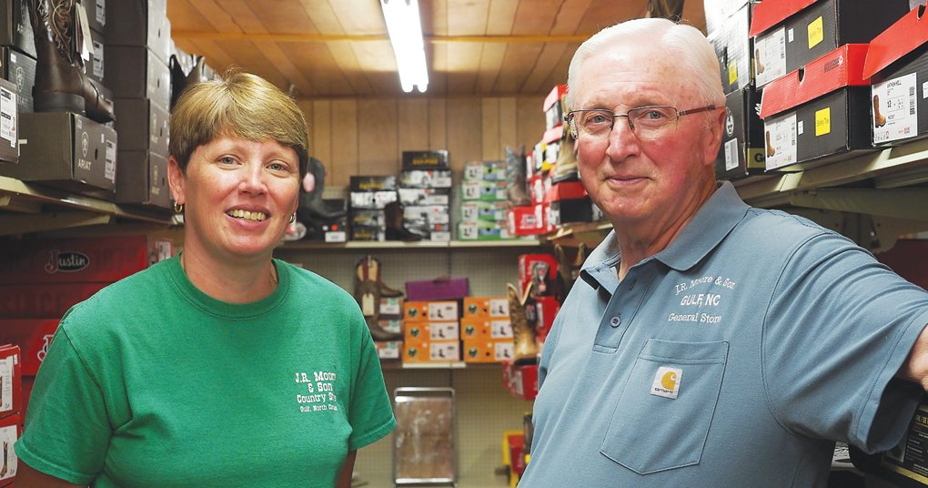 'I'm proud of what he has done and created,' said JR Moore & Son's Julie King-McDaniel, pictured here with her father Rayvon King, who has owned the store since 1968.
