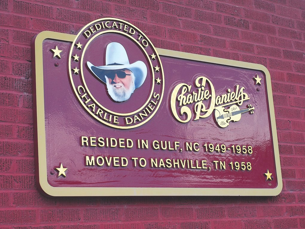 A plaque honoring Charlie Daniels at JR Moore & Son, a store in Gulf where Daniels and his friend, Russell Palmer, would play music on the porch.