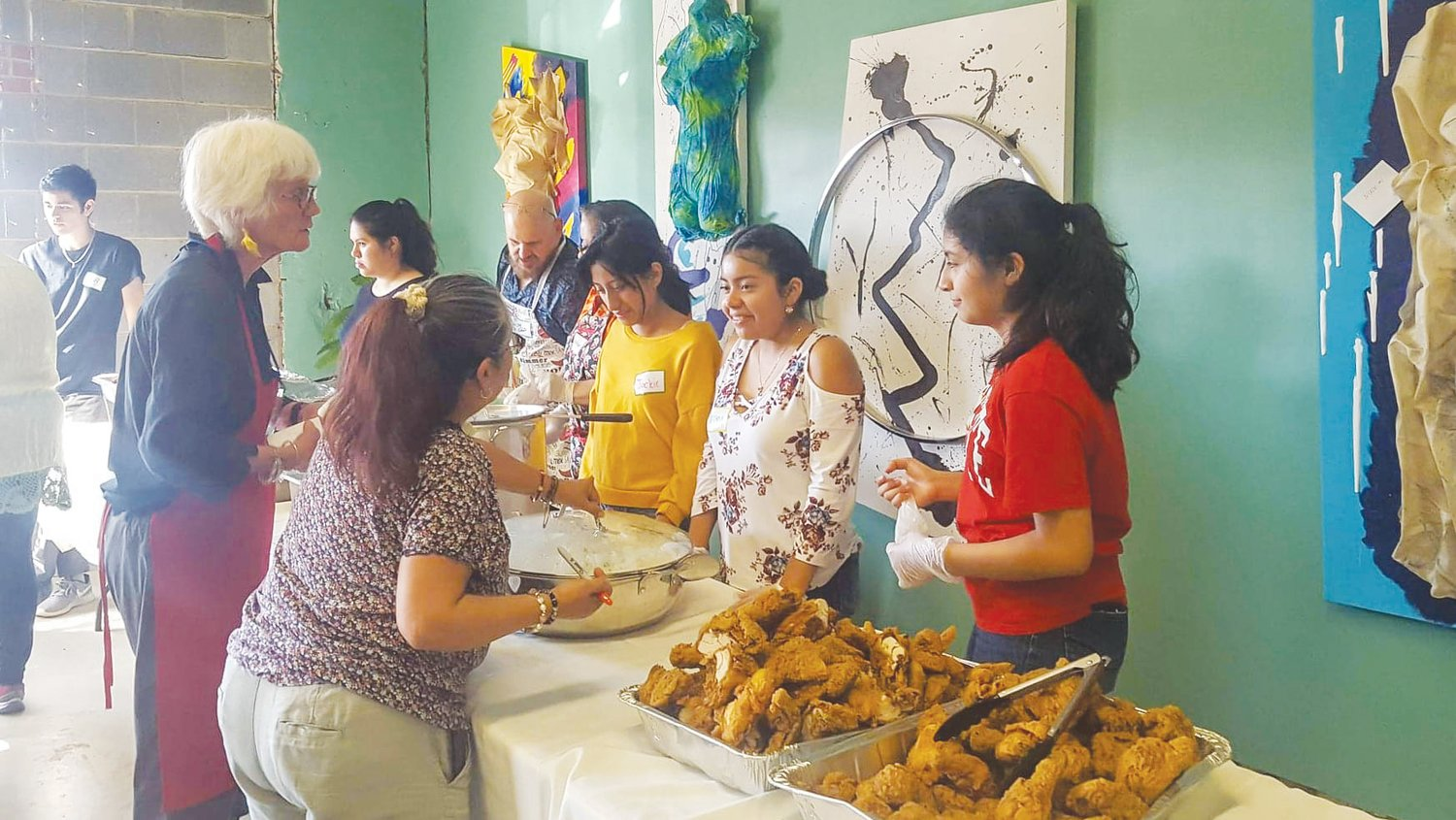 Members of the Hispanic Liaison's youth group, Orgullo Latinx Pride, help out during the community dinner held annually at Peppercorn in the fall.