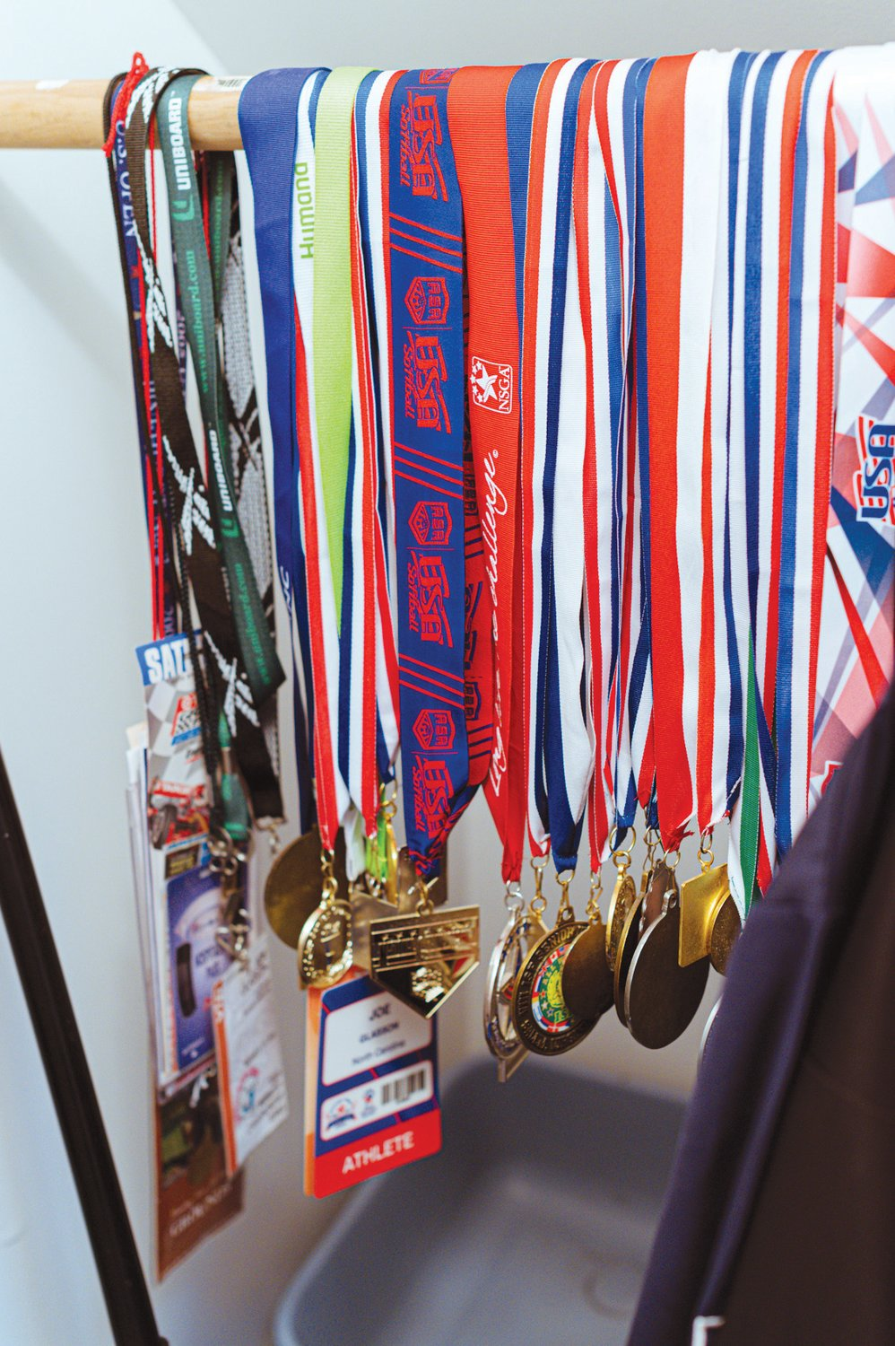 Glasson keeps a closet's worth of plaques, medals and jackets from his various softball championships.