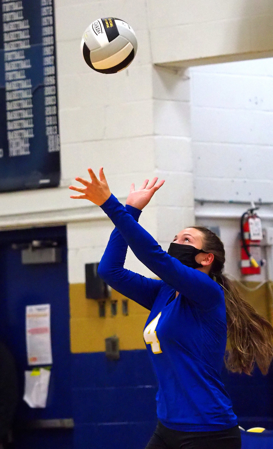Jordan-Matthews senior outside hitter Eve Long (4) winds up for a serve in a home match against Eastern Randolph on Tuesday, Dec. 15