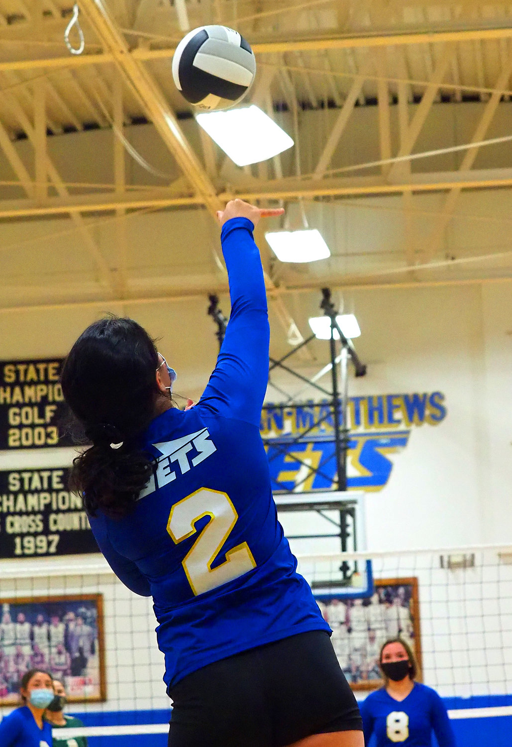 Jordan-Matthews junior middle hitter Alana May (2) hits a serve against Eastern Randolph in a Dec. 15 home match.