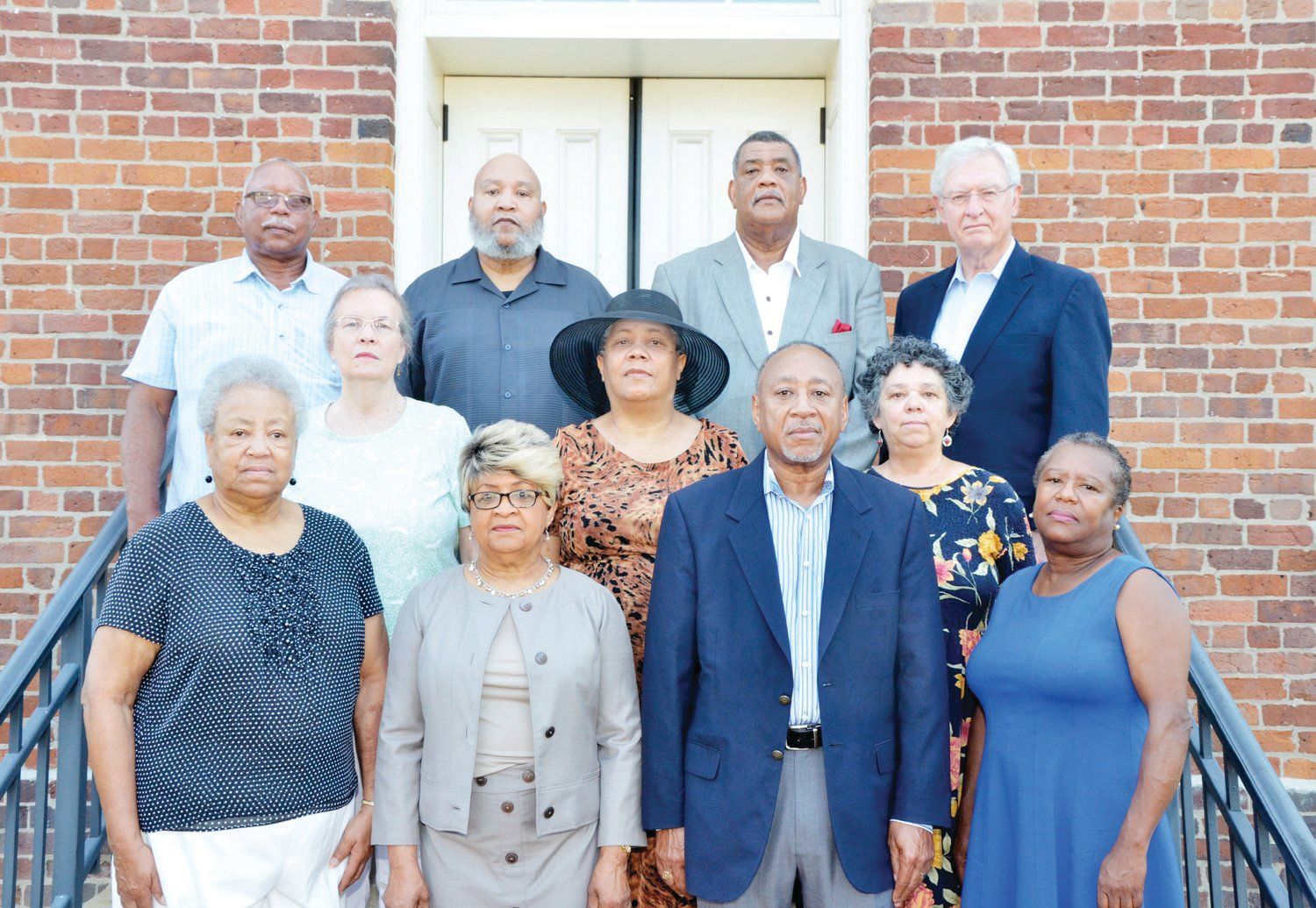 In this file photo, members of Chatham County's two NAACP chapters involved in an effort to memorialize the six victims of racial terror lynching in Chatham stand on the steps of the PIttsboro courthouse. This same group was involved in the creation of the Community Remembrance Coalition. Front row, from left: Armentha Davis, Mary Harris, Larry Brooks and Mary Nettles. Middle row, from left: Vickie Shea, Cledia Holland and Linda Batley. Back row, from left: Glenn Fox, Wayne Holland, Carl Thompson and Bob Pearson. Pearson, a retired attorney and diplomat who lives in Fearrington Village, was responsible for getting the effort started.
