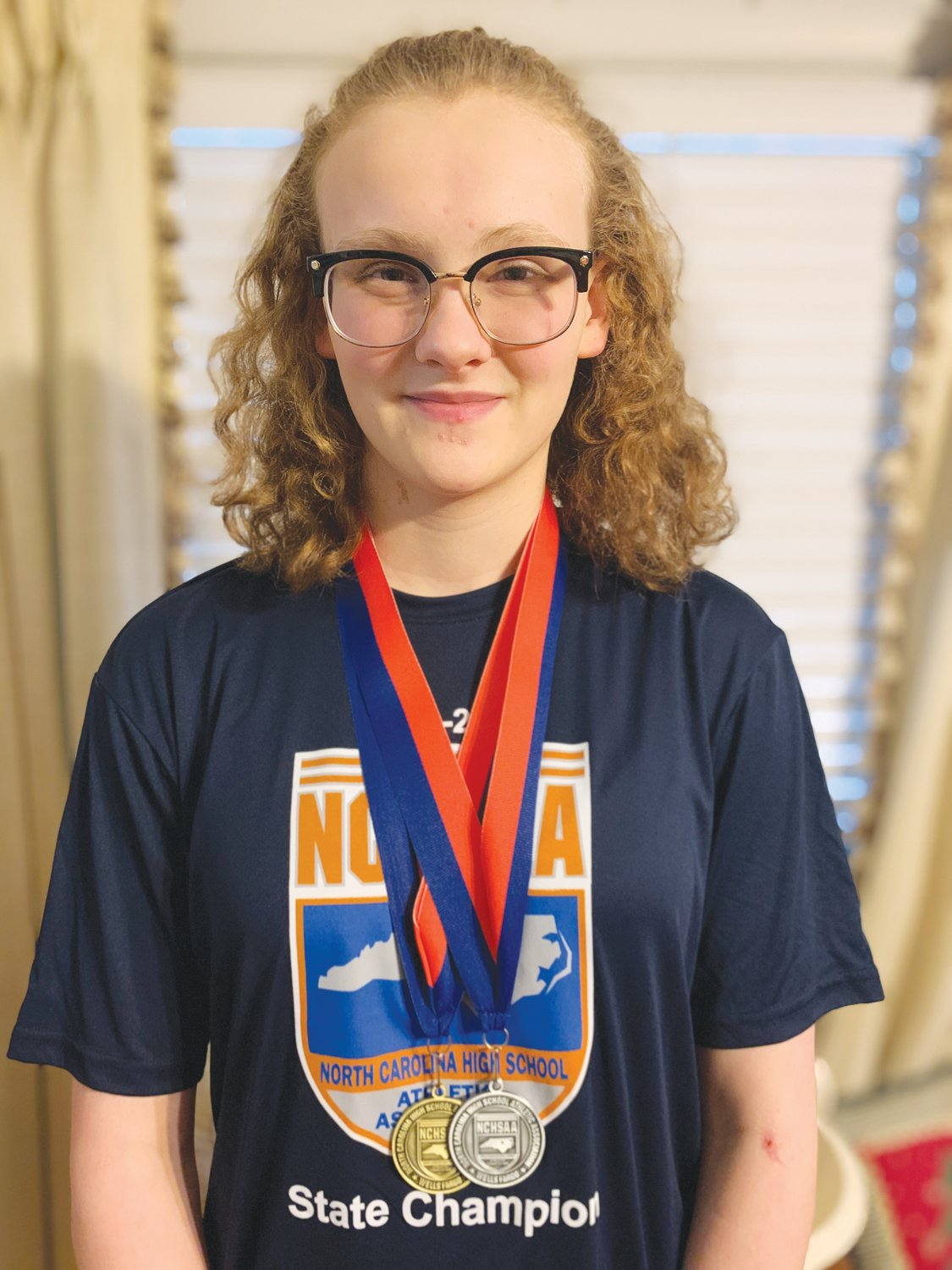 Jordan-Matthews' Jennah Fadely poses with the two medals she won at the NCHSAA 1A/2A Swimming State Championships on Friday in Cary. Fadely would take the state title with a record-setting time of 1:02.11 in the women's 100 breaststroke.