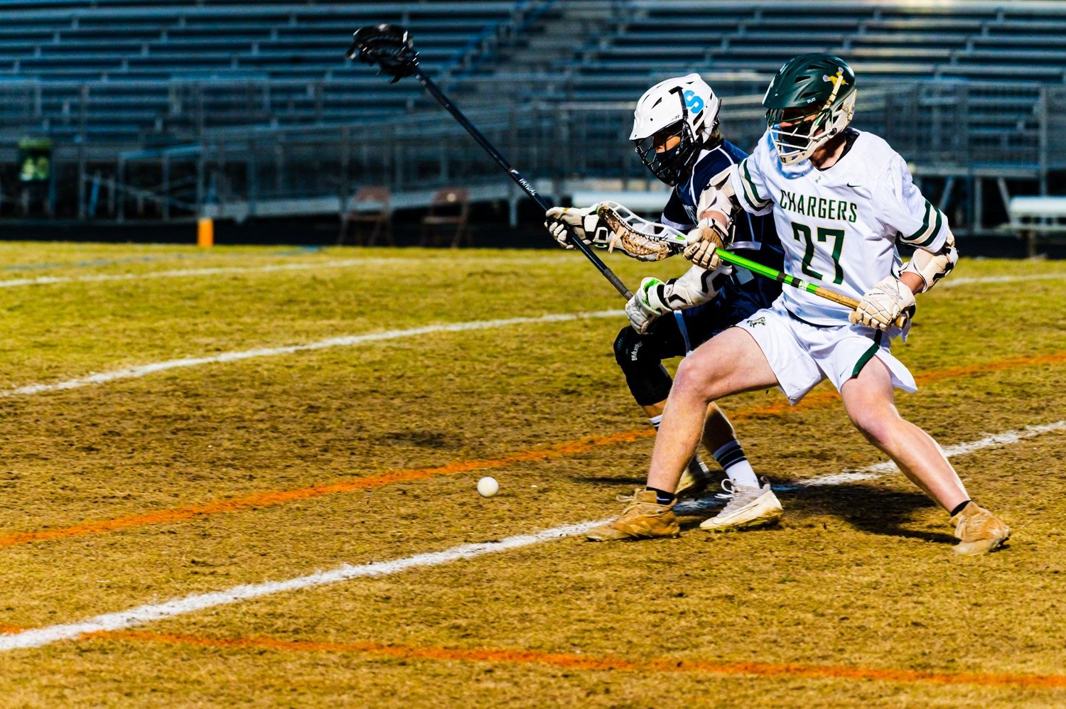 Northwood senior midfielder Brayden Foege (27) fights for a ground ball during his team's 17-8 win over Swansboro in the first round of the playoffs.