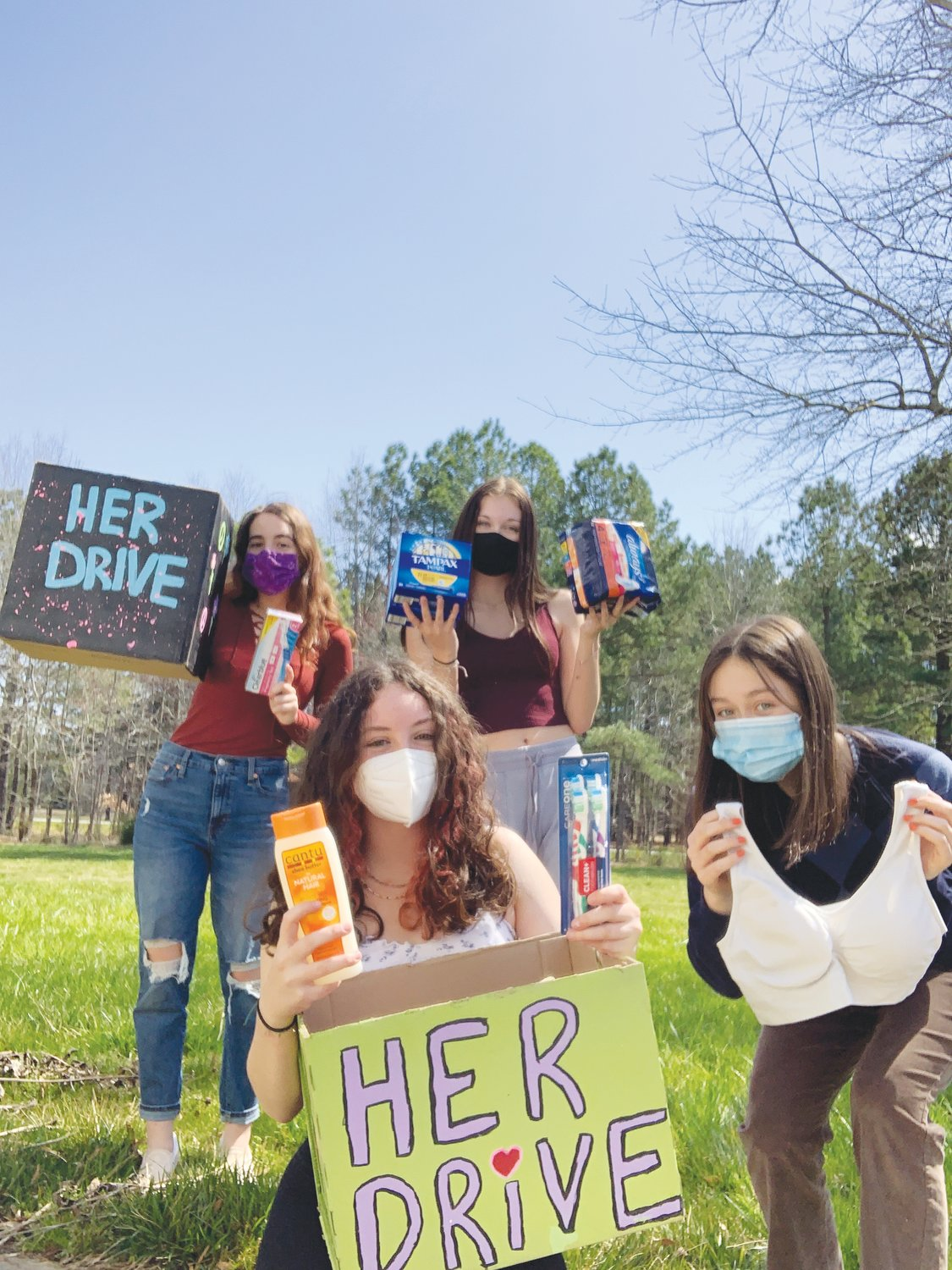 Annika Lowe (bottom right) began a donation drive in Chatham to collect menstrual care products with her friends, Angelina Parker-Lewis (top left), Emma Dickerson (top right) and Geneva Yarger-Woolford.