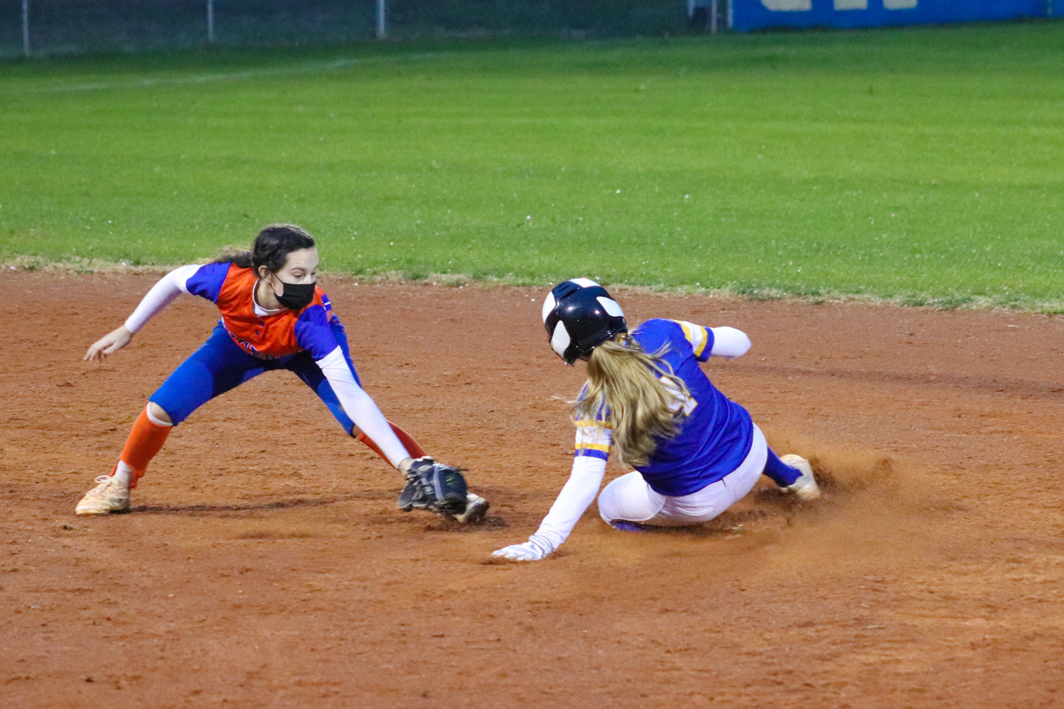Jordan-Matthews senior second baseman Eve Long (4) steals second base in her team's season-opening loss to Randleman, 15-5, on Tuesday. Long was one of six Jets to steal a base against the Tigers.