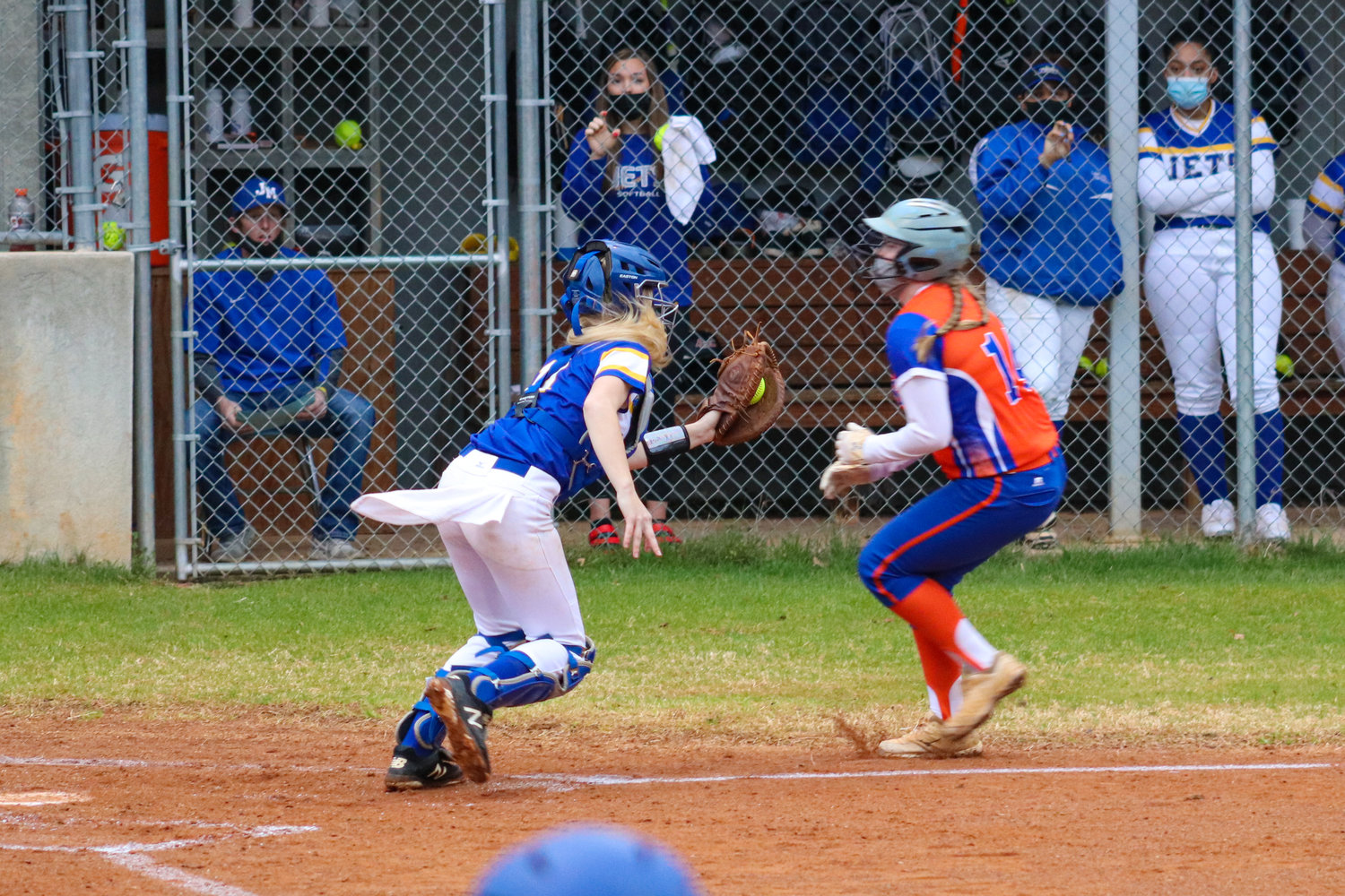 Jordan-Matthews freshman catcher Ragan Smith (left) tags out a Randleman baserunner as she heads to home in the Jets' season-opening loss to Randleman, 15-5, on Tuesday.