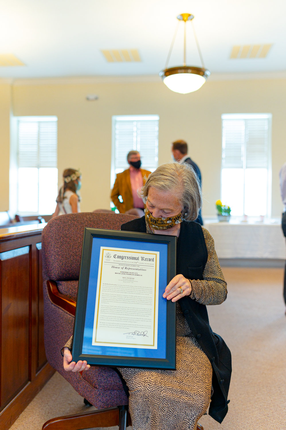 Cecilia Grimes holds the Congressional Record, which was submitted to Congress on Dec. 7 — the anniversary of the bombing of Pearl Harbor.