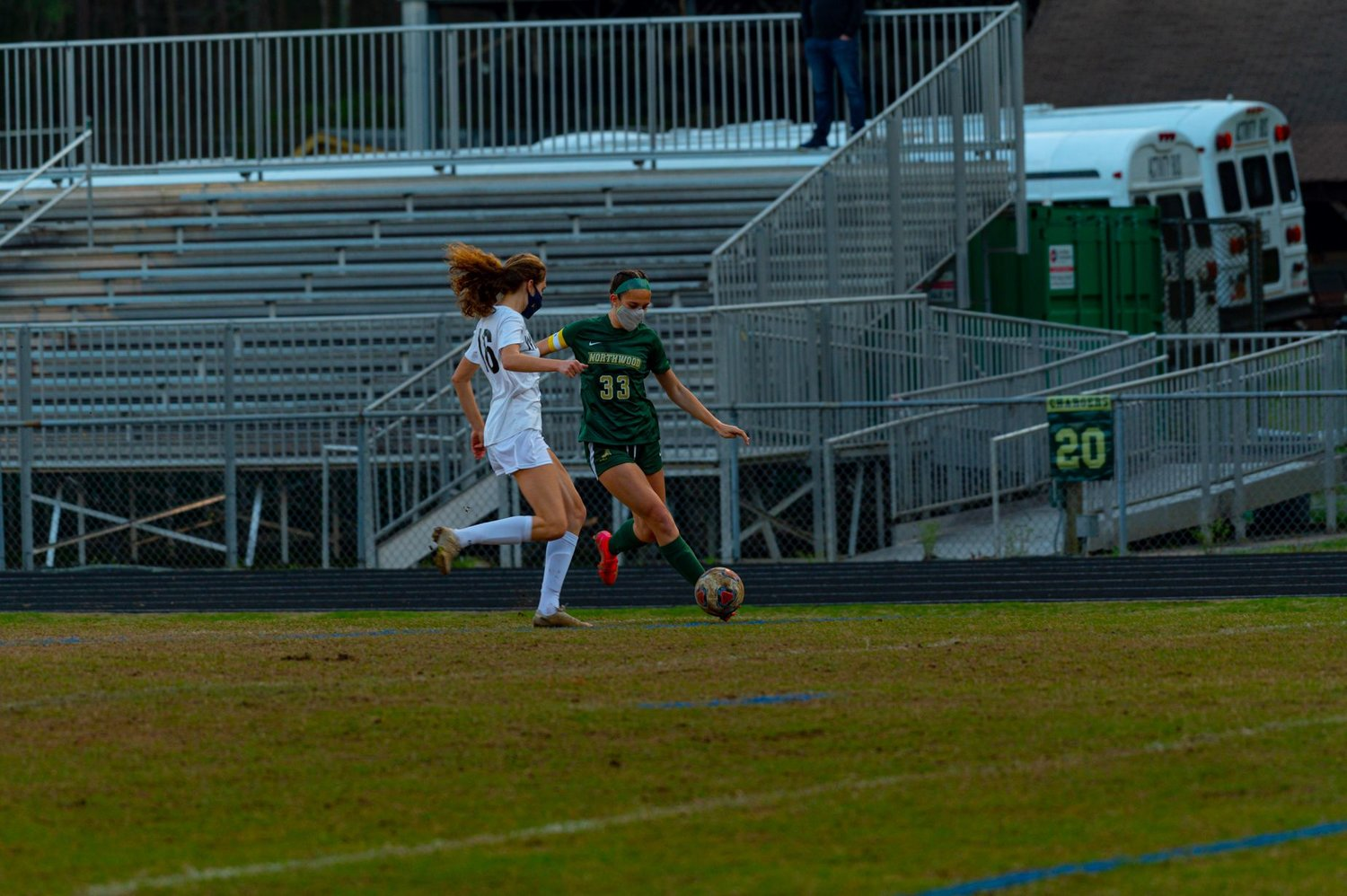 Northwood senior forward Imogene Cook prepares to send in a cross as East Chapel Hill defender Claire Parker attempts to close her down. Cook, one of three seniors on Northwood, had a strong individual performance in the Chargers' 2-0 loss to East Chapel Hill on March 30 in Pittsboro.