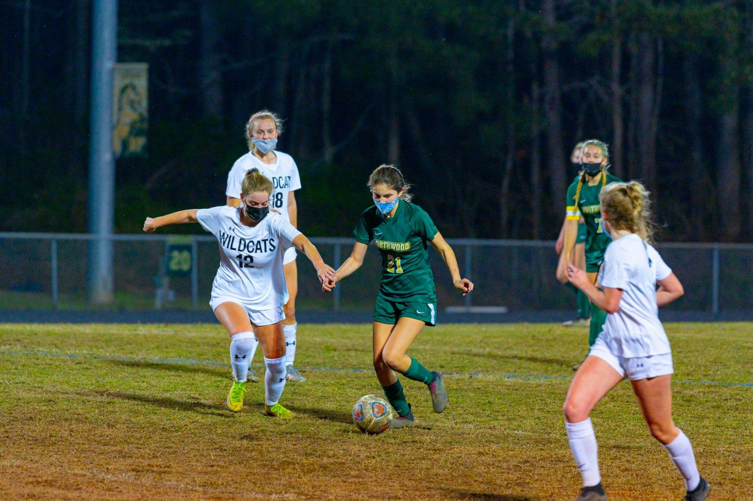 Northwood freshman midfielder Ava Arias dribbles past East Chapel Hill's Stewart Jones during her team's 2-0 loss to the Wildcats on March 30 in Pittsboro. Arias leads the Chargers with five goals on the season.