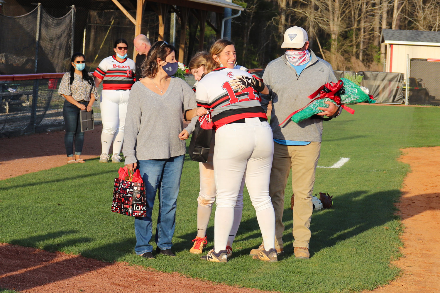 Chatham Central senior Mary Grace Murchison is hugged by her teammate, Mary Gaines (14), during the senior night festivities before her team's 12-0 win over North Rowan on March 30. Murchison went 1-for-3 with an RBI in the victory.