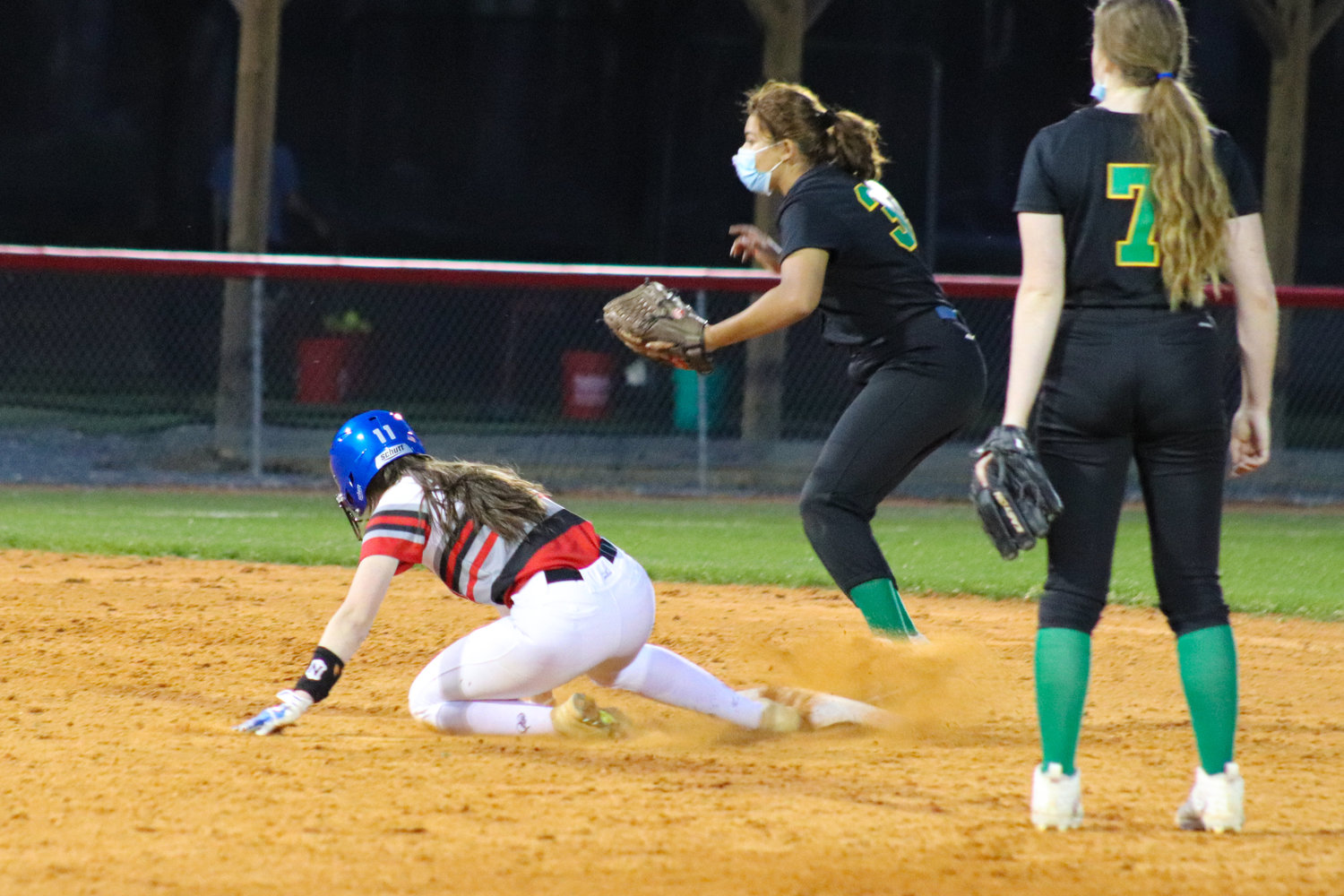 Chatham Central junior Lindsey Johnson (red and white) slides into second base in her team's 12-0 victory over North Rowan on March 30. She went 1-for-2 on the night.