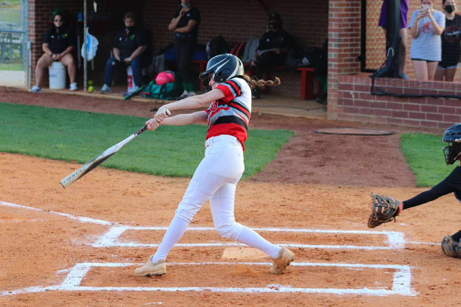 Chatham Central junior Gracie Gaines swings at a pitch in her team's 12-0 victory over North Rowan on March 30. Gaines led the team with 4 RBI on the night.