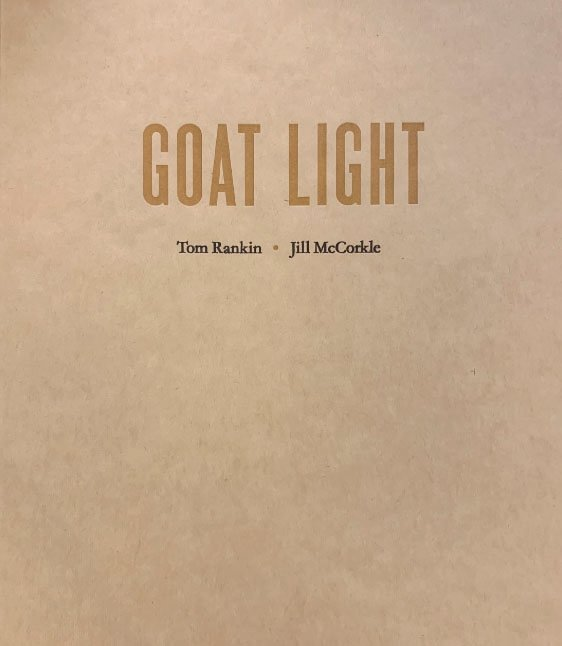 Goat Light is published in two limited editions — an edition of 750 sewn copies, offset printed in full color on 120-pound, uncoated text-weight, bright-white paper, and with covers printed on a hand-fed, hand-cranked letterpress. The heavyweight uncoated cover stock is a mottled color somewhere between that of burlap and a hay bale. A deluxe, limited edition of 26 copies, lettered A–Z, and signed by both Tom and Jill, includes an 8-by-10 inch selenium-toned, gelatin-silver contact print of an image not found in the book.