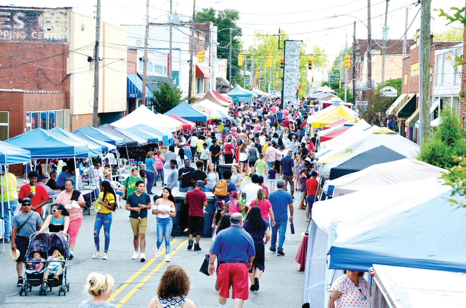 A warm Saturday and a threat of rain didn't keep the crowds from attending the Spring Chicken Festival Saturday in downtown Siler City. Chatham Avenue was blocked off for fun, food and face-painting, with more than 5,000 people attending.