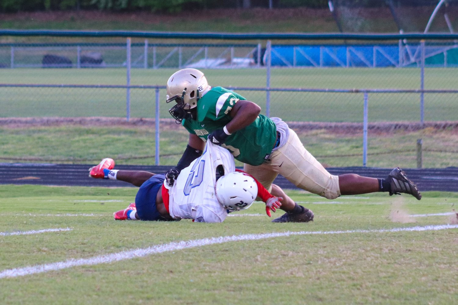 Northwood senior defensive tackle Christopher Polston (73) slams a West Carteret ball carrier to the ground in his team's 17-0 win over the Patriots on Friday.