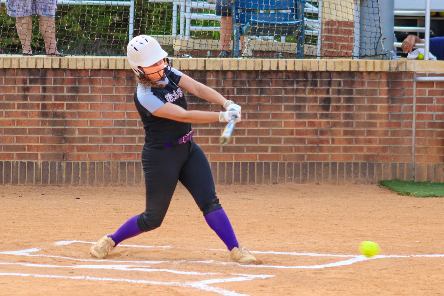 Chatham Charter junior Taylor Jones makes contact with the ball in her team's 4-3 loss to Forsyth Country Day on Thursday, April 15. Jones was 1-for-3 on the day.