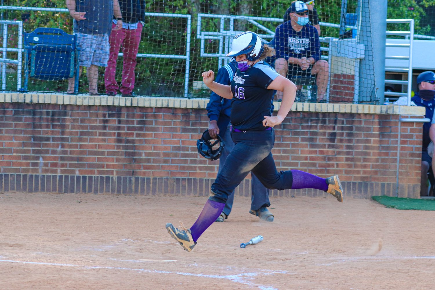 Chatham Charter senior catcher Morgan Lineberry (16) scores on an error in the sixth inning of her team's 4-3 loss to Forsyth Country Day on Thursday, April 15.