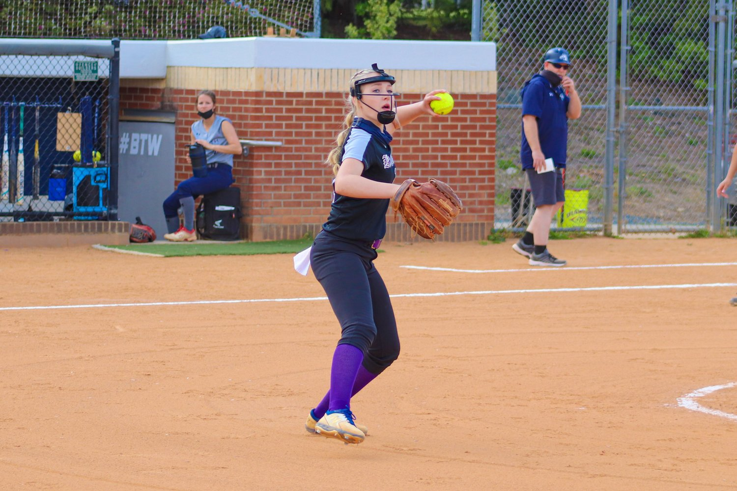 Chatham Charter senior pitcher Sydney Bowman looks to throw the ball to first base in her team's 4-3 loss to Forsyth Country Day on Thursday, April 15. Bowman pitched 5 full innings, allowing 9 hits and 4 earned runs, striking out 6.