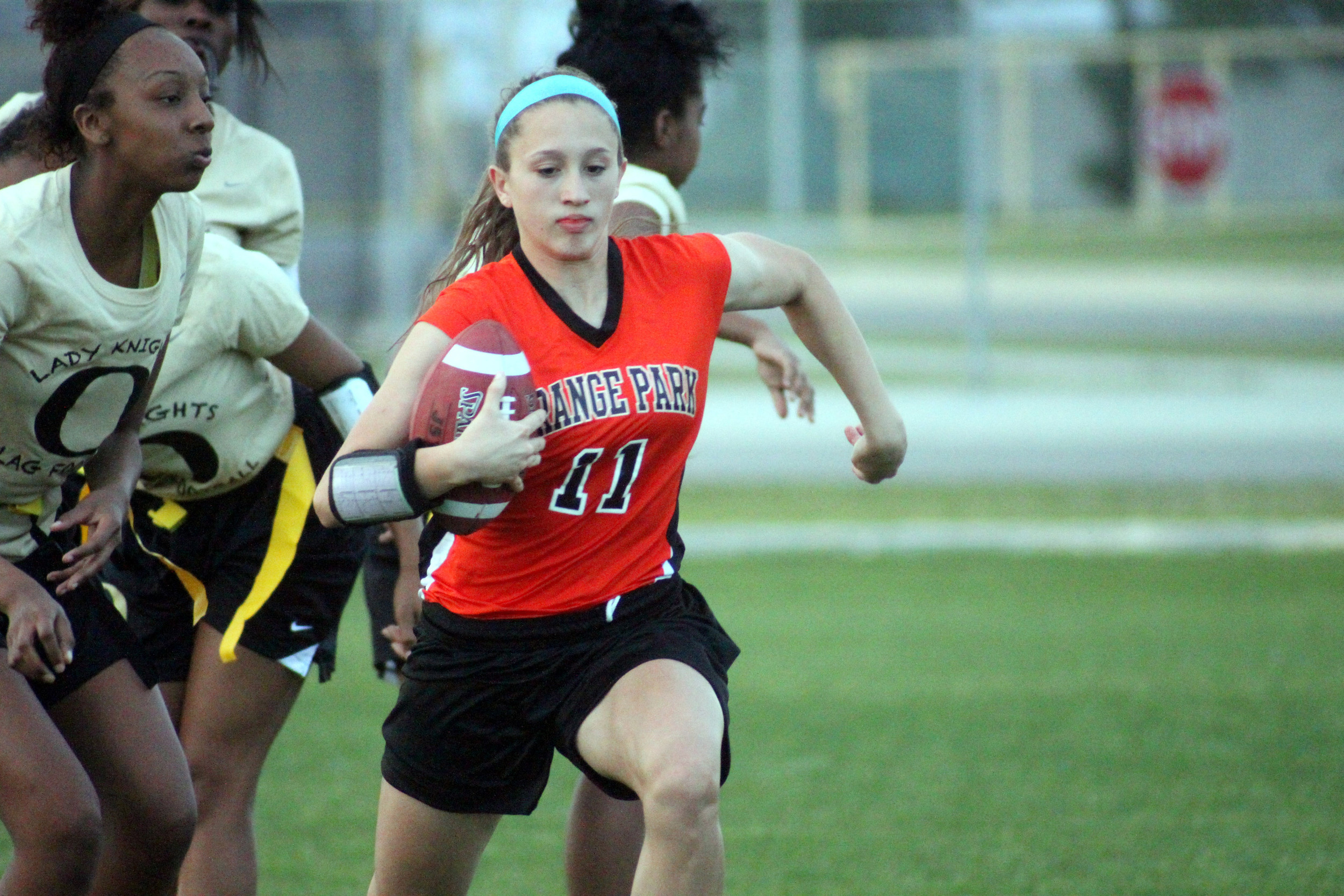 Orange Park flag football ballcarrier Angie DeMichele and her Lady Raiders lost an overtime game to Fleming Island that kept the Raiders from advancing into the state playoffs. Fleming Island lost to FAMU in the state quarterfinals.