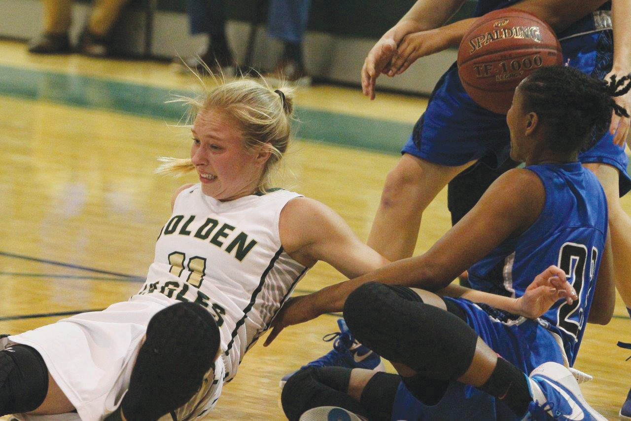 Fleming Island guard Hannah McGrory sprawls while trying to steal a ball from Bartram Trail's point guard. Golden Eagles had strong first half, but lost with a dismal second half shooting effort.