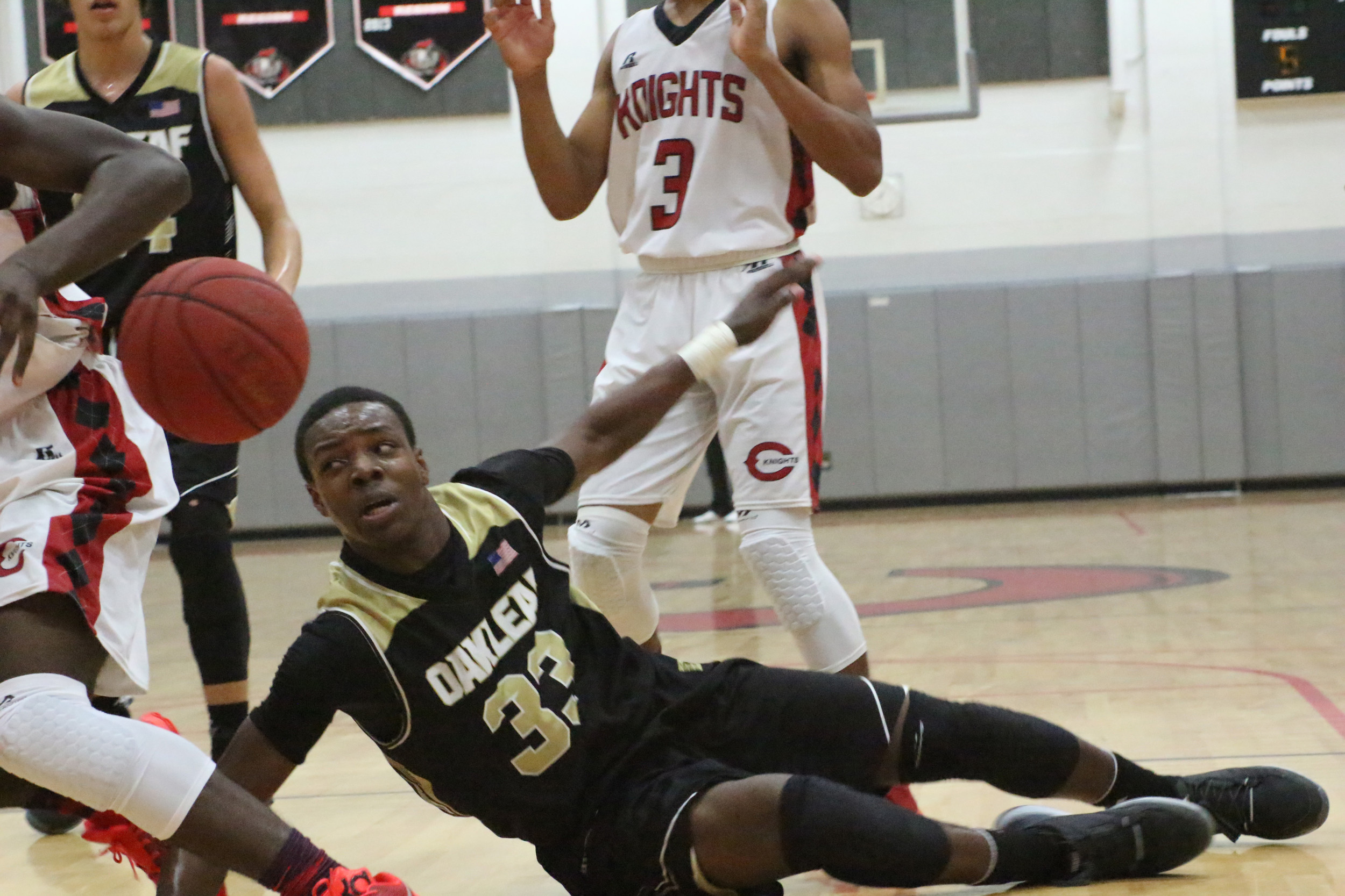 Oakleaf High top scorer Jonathan Bryant got bumped and battered every time he drove through the lane as Creekside bottled up the  middle in their 4-7A win.