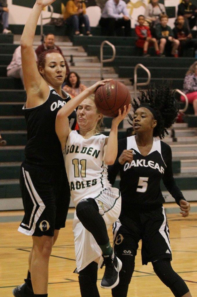 Fleming Island guard Hannah McGrory finds tough defense from Oakleaf High's Baileigh Larson, left, and Sabria Littles in Knights 80-50 win on Friday.